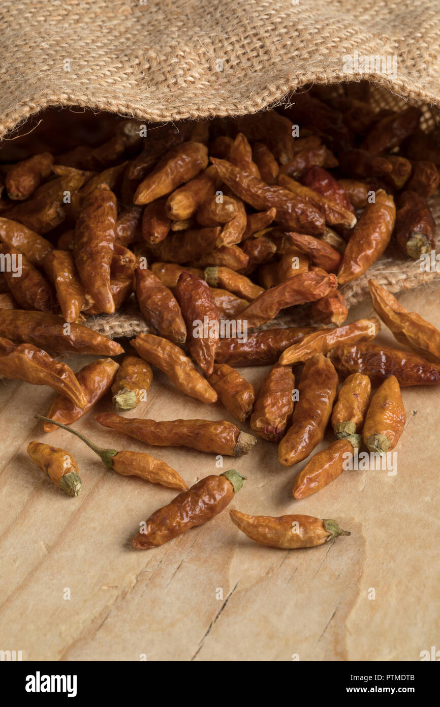 Jute sack with red hot chili peppers closeup - Stock Image