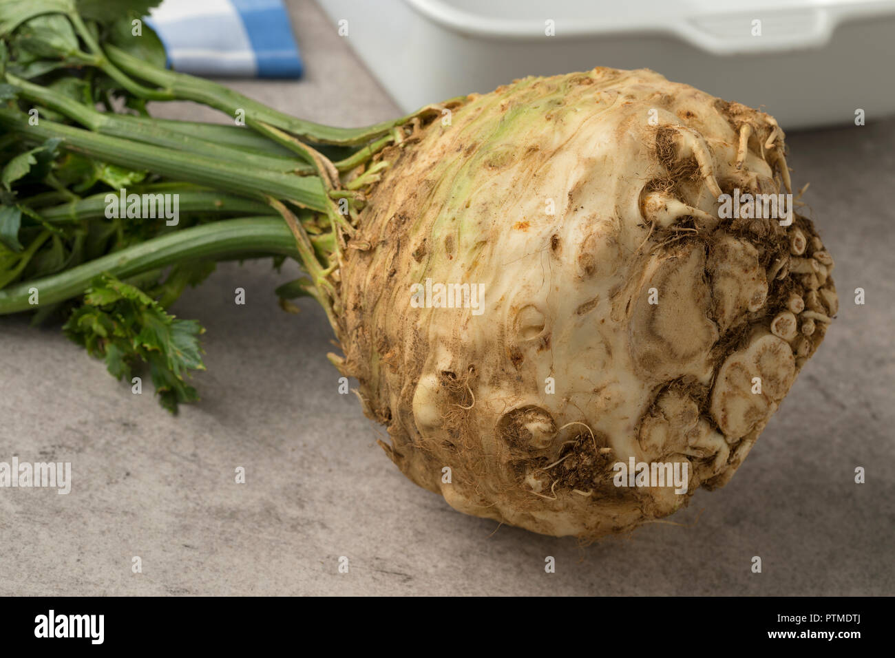 Fresh raw organic celery root and leaves closeup Stock Photo