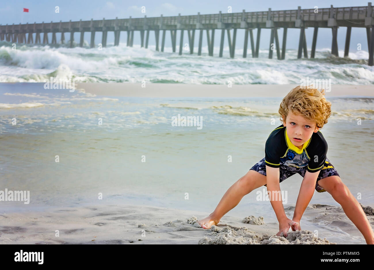 Pensacola Beach, Florida, USA. 9th Oct 2018. Noah Majors, 7, makes sand castles at Pensacola Beach pier as waves from Hurricane Michael churn up the Gulf, Oct. 9, 2018, in Pensacola Beach, Florida. Although red flags warned visitors to stay out of the water, that didn't stop them from gathering on the beaches across the Florida Panhandle to enjoy the surf. Hurricane Michael is expected to make landfall in Panama City, Oct. 10, 2018, as a category four hurricane.  Credit: Carmen K. Sisson/Cloudybright/Alamy Live News Stock Photo