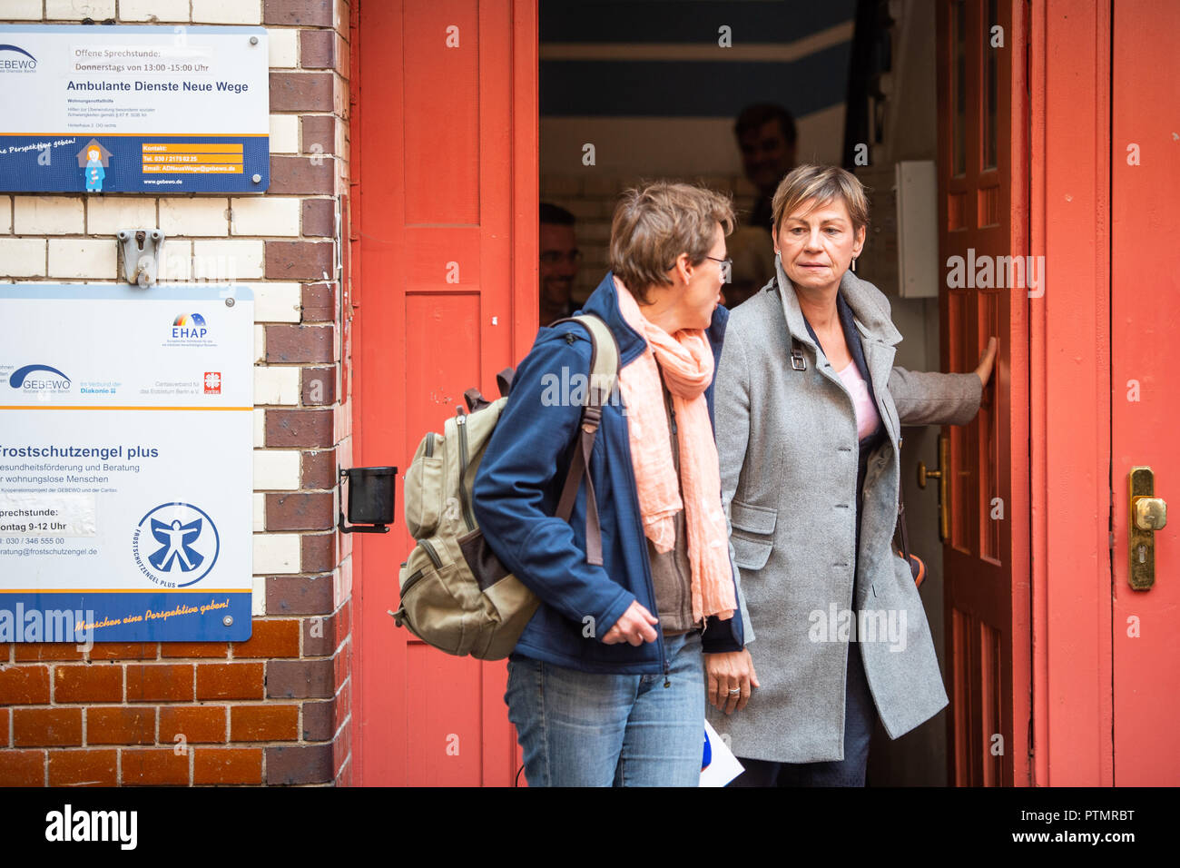 10 October 2018, Berlin: Elke Breitenbach (r, Die Linke), Senator for Integration, Labour and Social Affairs, is leaving the building of the coordination office for location development for cold aid. On Wednesday, the Berlin Senator for Integration, Labour and Social Affairs Breitenbach (Die Linke) visited Berlin institutions of homeless help. Photo: Arne Immanuel Bänsch/dpa Stock Photo
