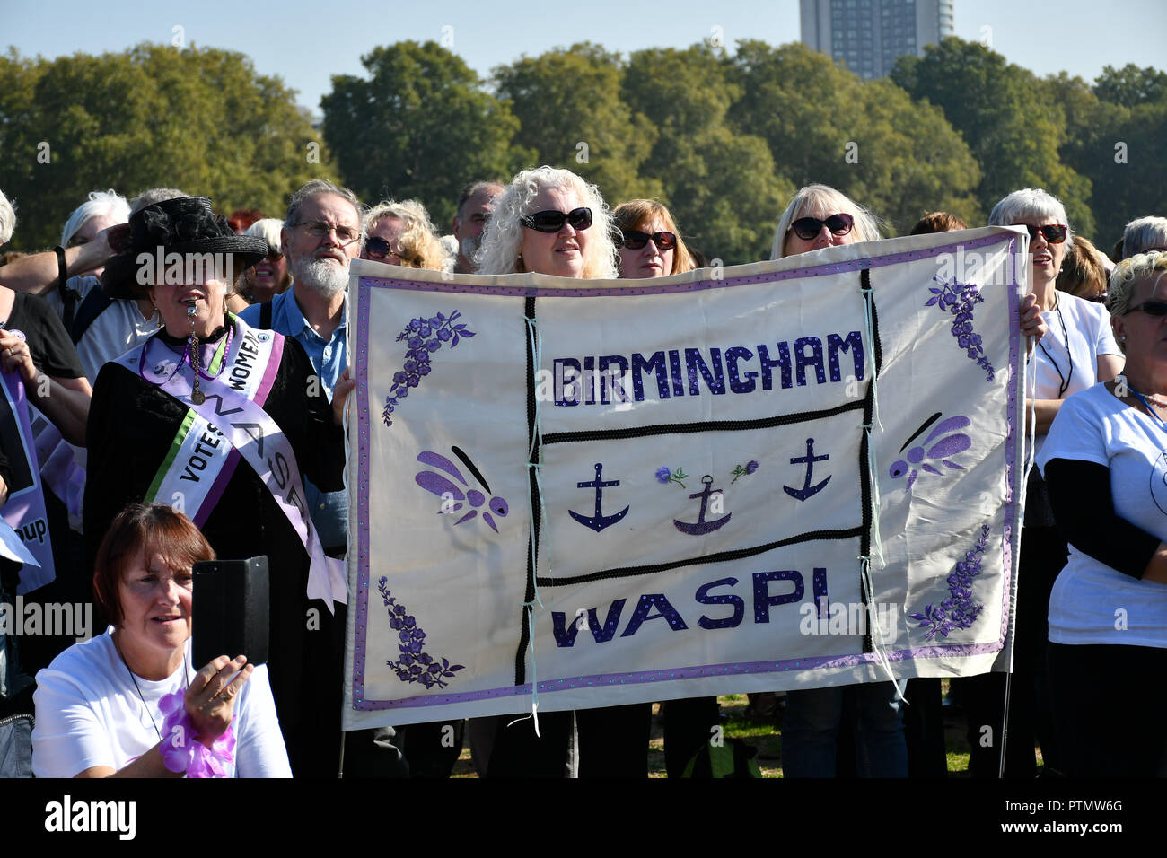 London, UK. 10th Oct 2018. Hundreds of pensioner rally The 1950s Women's State Pension Campaign, Back to 60, We Paid In, You Paid Out and other women's pension groups will join together 'Shoulder to Shoulder' as #OneVoice chanting Theresa May how many people you robs today demand their pension to be pay now not when we will dead at Reformer's Tree, Hyde Park, London, UK. 10 October 2018. Credit: Picture Capital/Alamy Live News Stock Photo