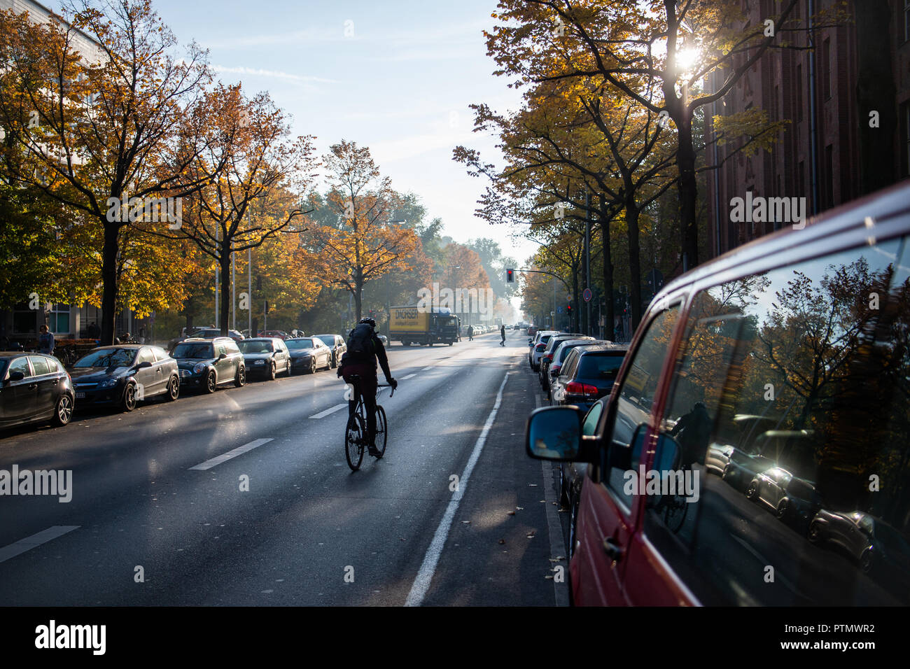 10 October 2018, Berlin: 10 October 2018, Germany, Berlin:A cyclist rides in the morning on the Oranienstrasse. Photo: Arne Immanuel Bänsch/dpa - Stock Image