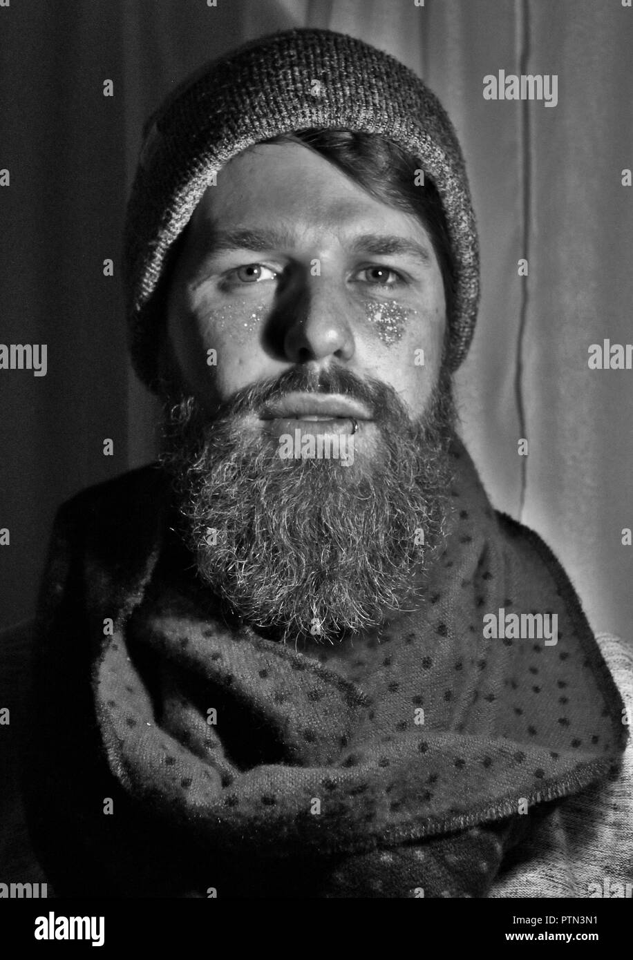 Bearded and pierced model - Stock Image