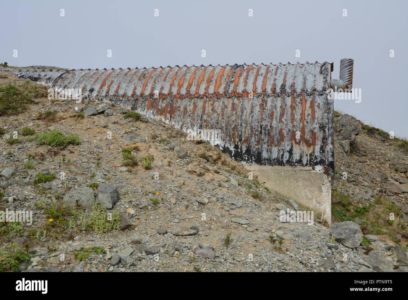 Entrance to a World War Two U.S. military base and bunker on Bunker Hill, over Dutch Harbor, Unalaska, Aleutian Islands, Alaska, USA. - Stock Image