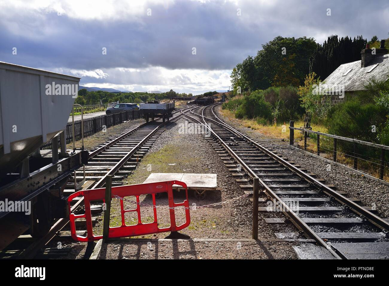 Broomhill, Scotland, United Kingdom. A mainline track and siding of the Strathspey Railway that splices through the Scottish Highlands. - Stock Image