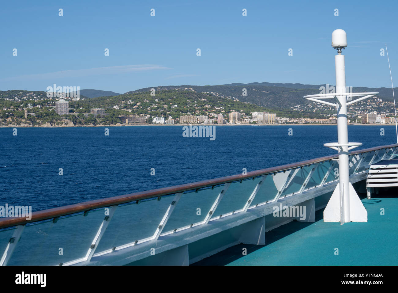 Oceanview from a Cruise Ship to the Ocean. The Island is in the background and the rail in the foreground - Stock Image