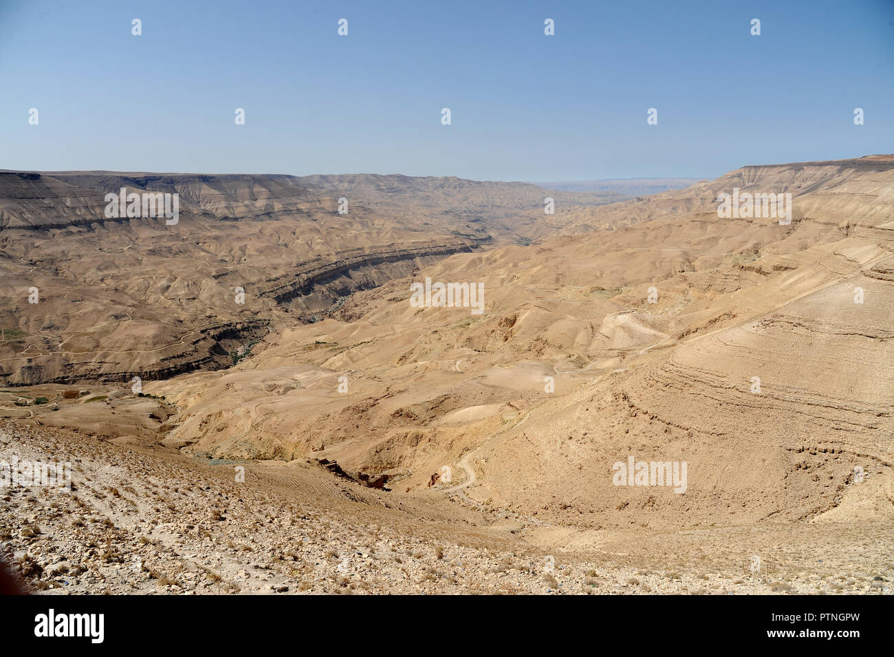 panoramic view from the King's Highway, which swoops over the high ridge of the Great Rift Valley. in Jordan Stock Photo