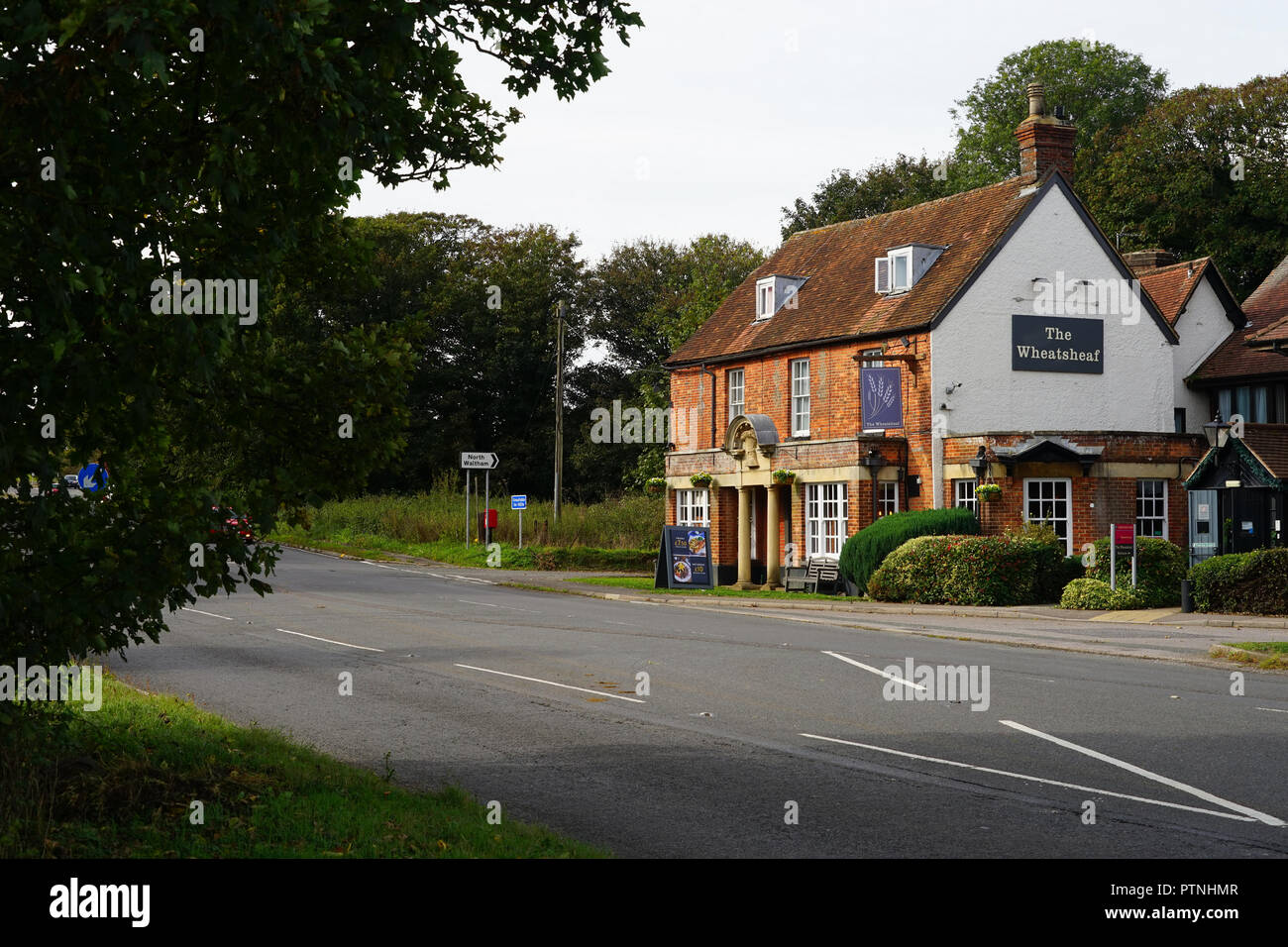 The Wheatsheaf Inn on the old London to Winchester coaching road at North Waltham - Stock Image