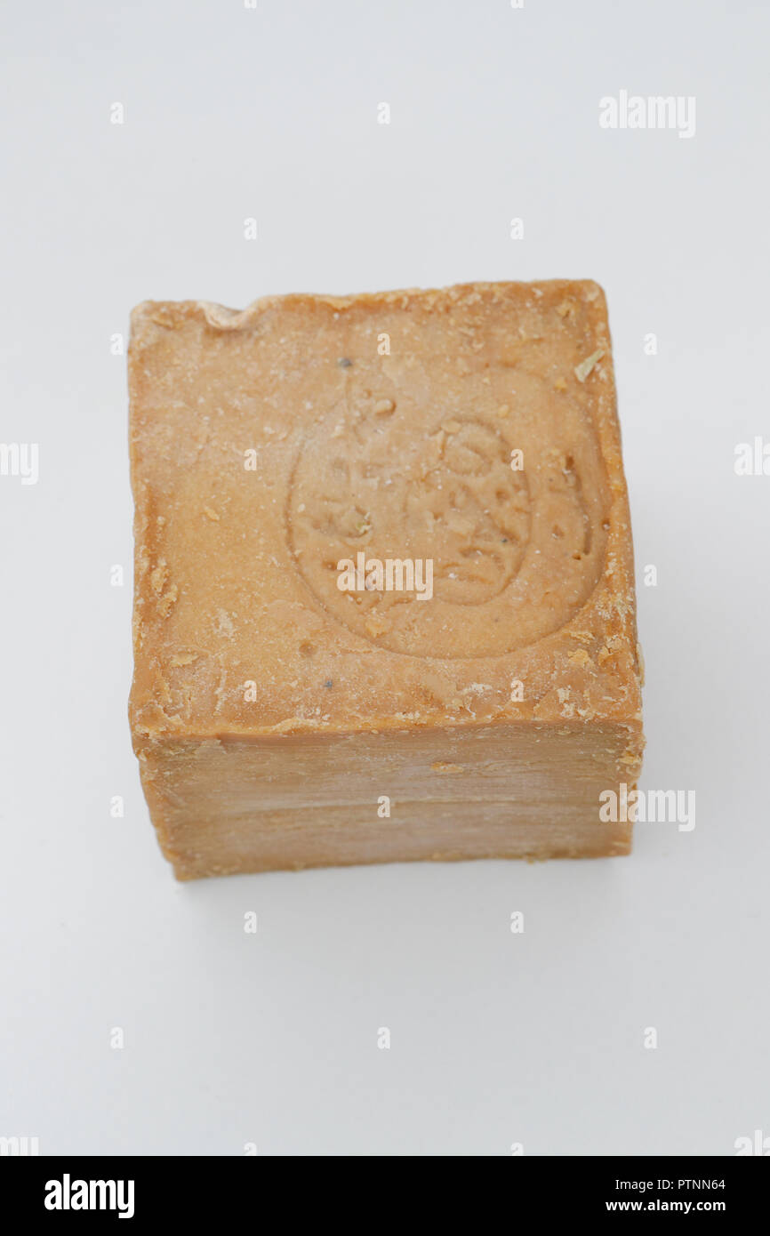 A cube of Marseille soap isolated on white background. Bodycare concepts. France - Stock Image