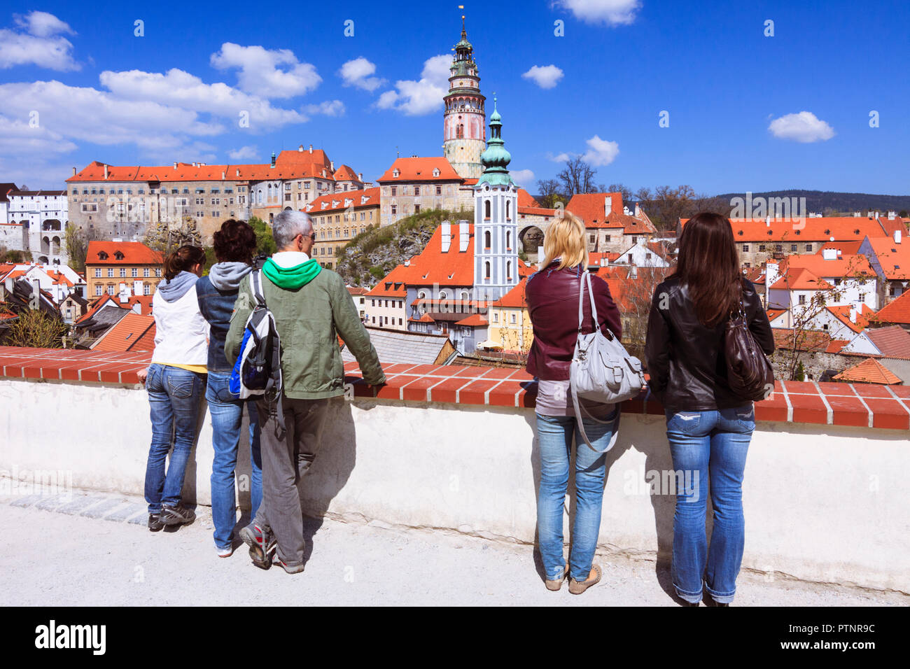 Cesky Krumlov, Bohemia, Czech Republic : People look at a panoramic viw of the old town and Krumlov Castle. - Stock Image