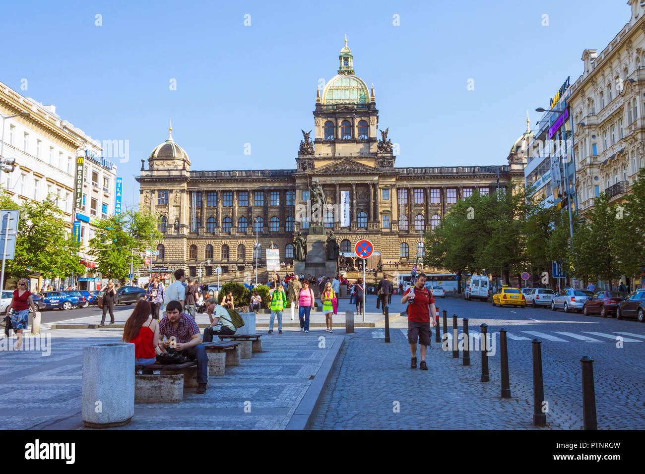 Prague, Bohemia, Czech Republic : People sit by the Czech National Museum at  Wenceslas square. - Stock Image