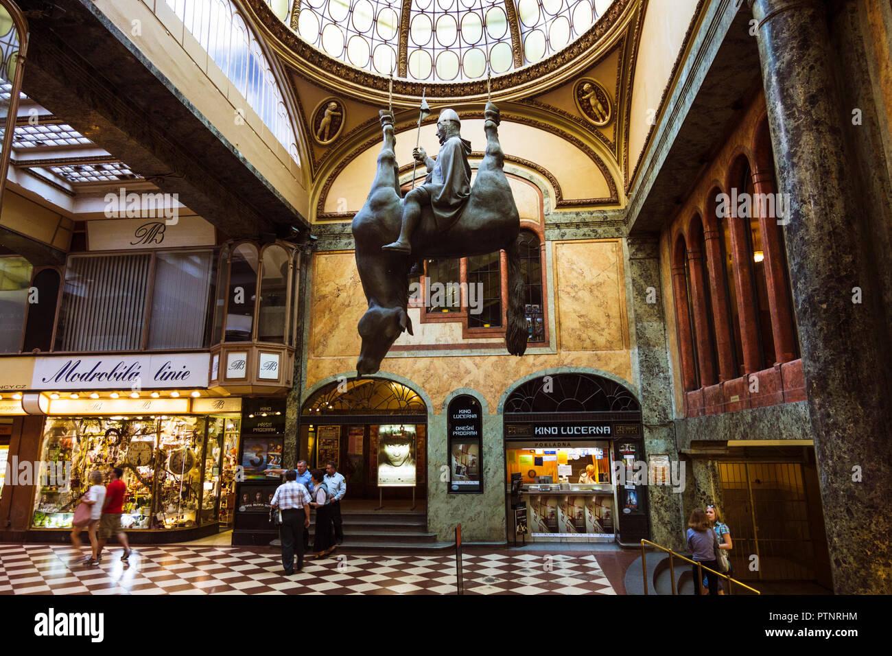 Upside-Down Statue of King Wenceslas Riding a Dead Horse By Czech sculptor David Černý at Lucerna Passage shopping center in Prague Czech Republic Stock Photo