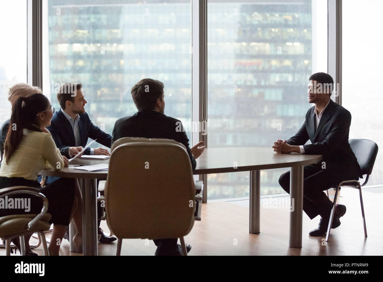 Confident black applicant impress recruiters during interview - Stock Image