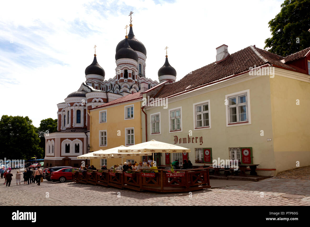 Visitors enjoy refreshments in hotel behind the Alexander Nevsky Cathedral Tallinn's largest and grandest orthodox cupola cathedral on hot summer day - Stock Image