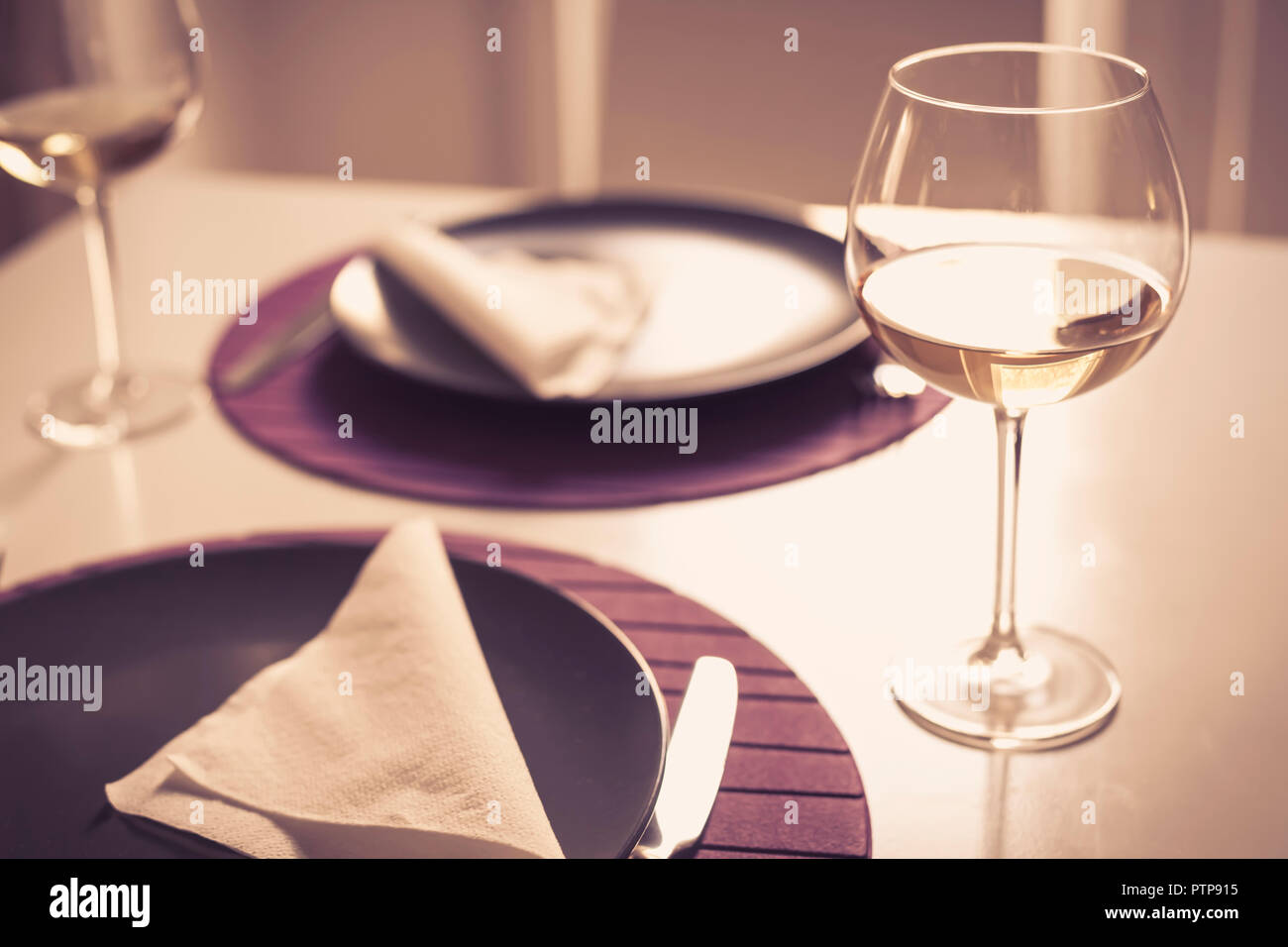 Romantic memories - Table setting for Two - Wine glasses with white wine - Stock Image