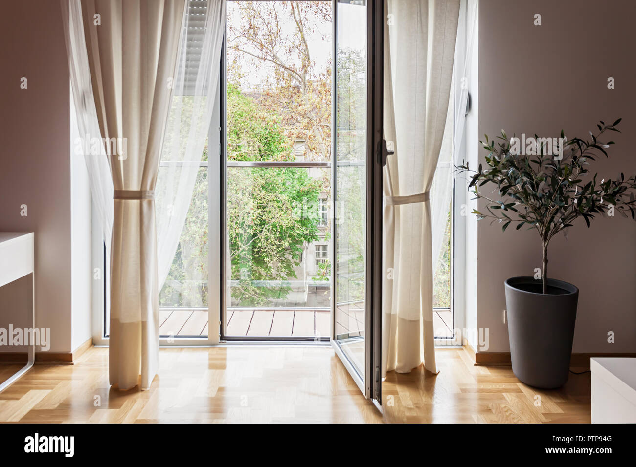 Modern Apartment View Through Open Glass Terrace Door Looking At Trees    Stock Image
