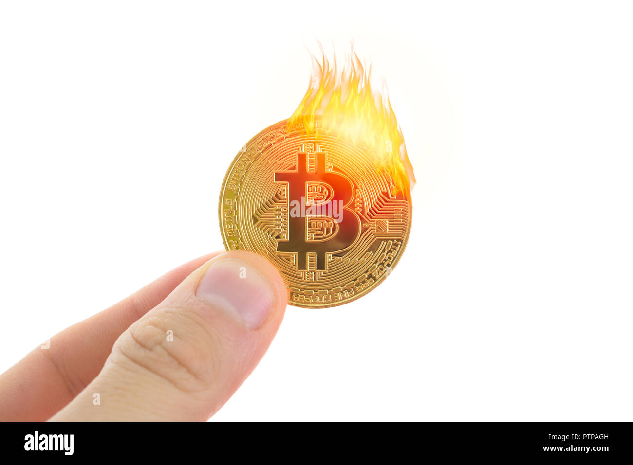 Burning bitcoin. The concept of the fall and collapse of the crypto currency. Stock Photo