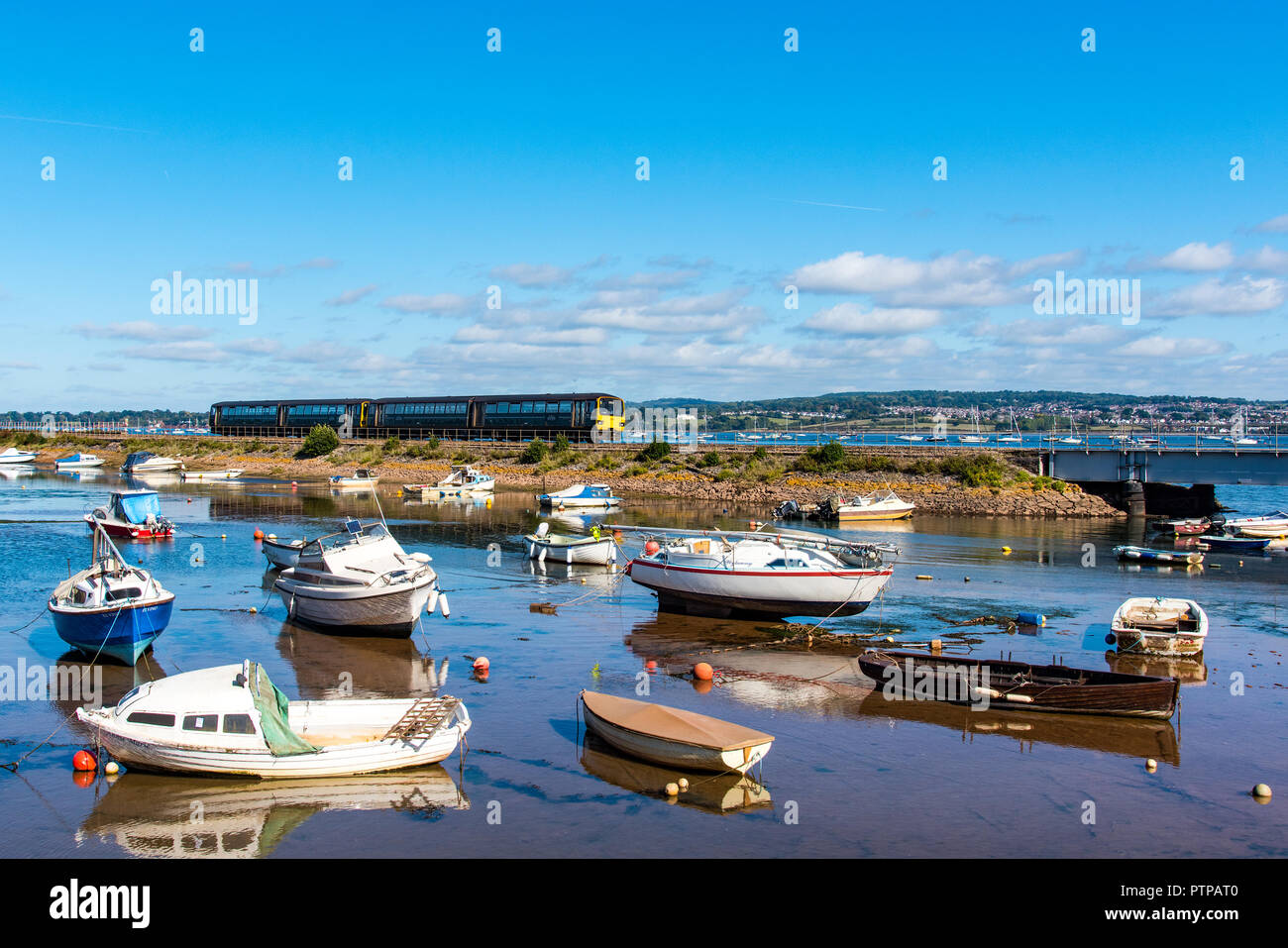 COCKWOOD, STARCROSS, DEVON, UK - First Great Western class 143 Pacer train 143621 passes the harbour at Cockwood on the Exe Estuary. - Stock Image