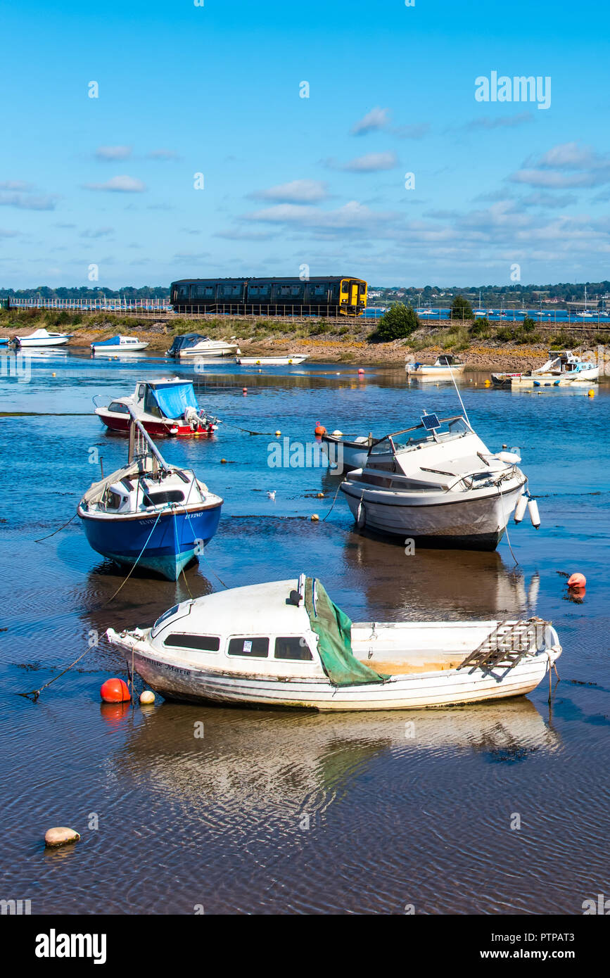 COCKWOOD, STARCROSS, DEVON, UK - First Great Western class 150 Sprinter train 150249 passes the harbour at Cockwood on the Exe Estuary. - Stock Image