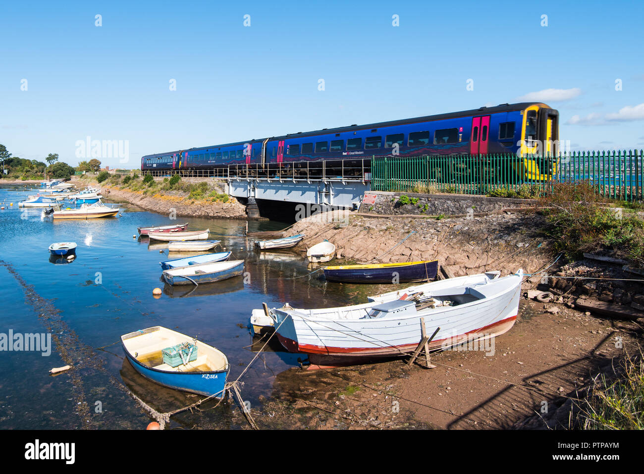 COCKWOOD, STARCROSS, DEVON, UK - 03OCT2018: First Great Western class 158 Express Sprinter train 158763 passes the harbour at Cockwood on the Exe Estu - Stock Image