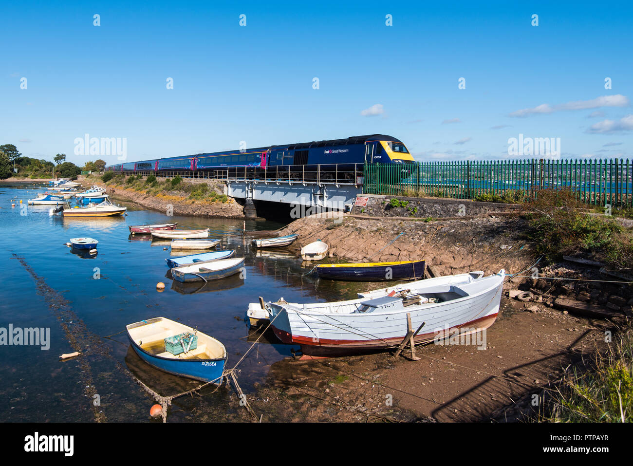 COCKWOOD, STARCROSS, DEVON, UK - First Great Western class 43 High Speed Train 43053 passes the harbour at Cockwood on the Exe Estuary. - Stock Image
