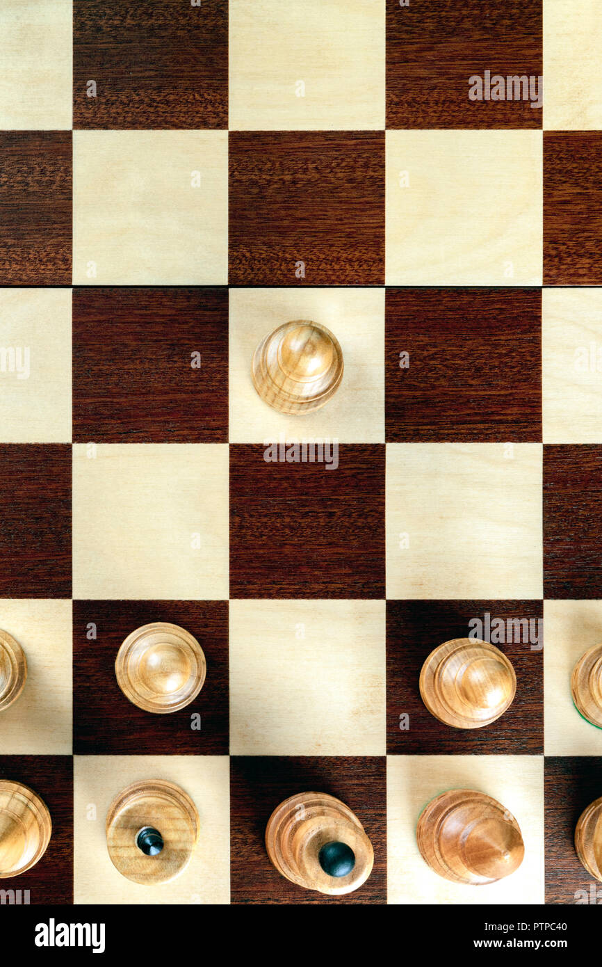 A pawn making the first move on a chessboard at the very beginning of the game - Stock Image