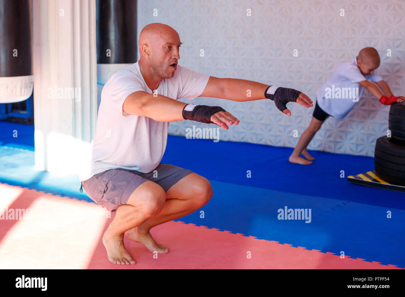 Boxing training in the gym, the concept of sports development. Stock Photo