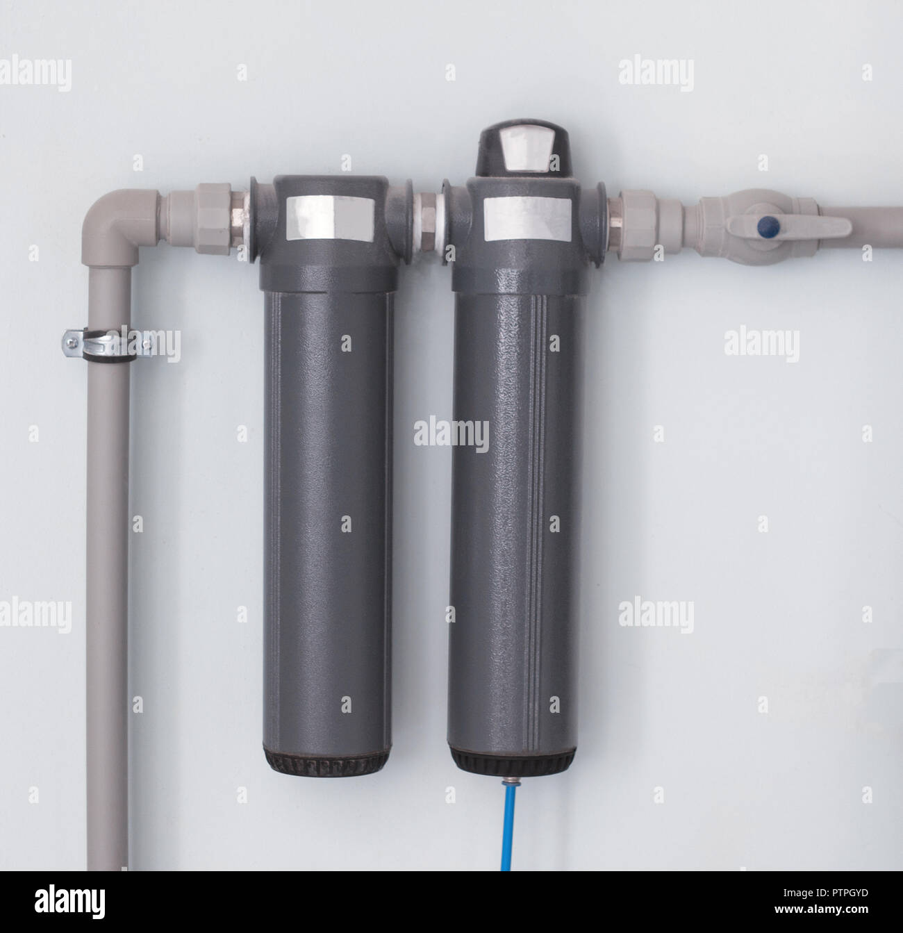 Two modern water filters for cleaning large amounts of water, water filters are located on the wall, close-up, water filter - Stock Image