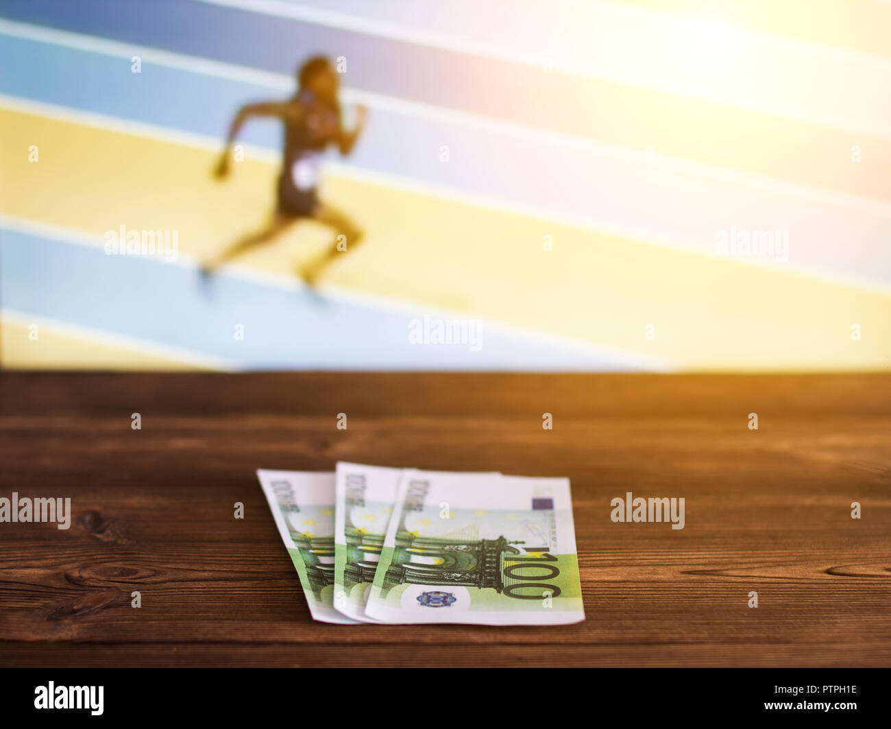 Euro money on the background of the TV on which show track and field athletics, jogging, sports betting, euro - Stock Image