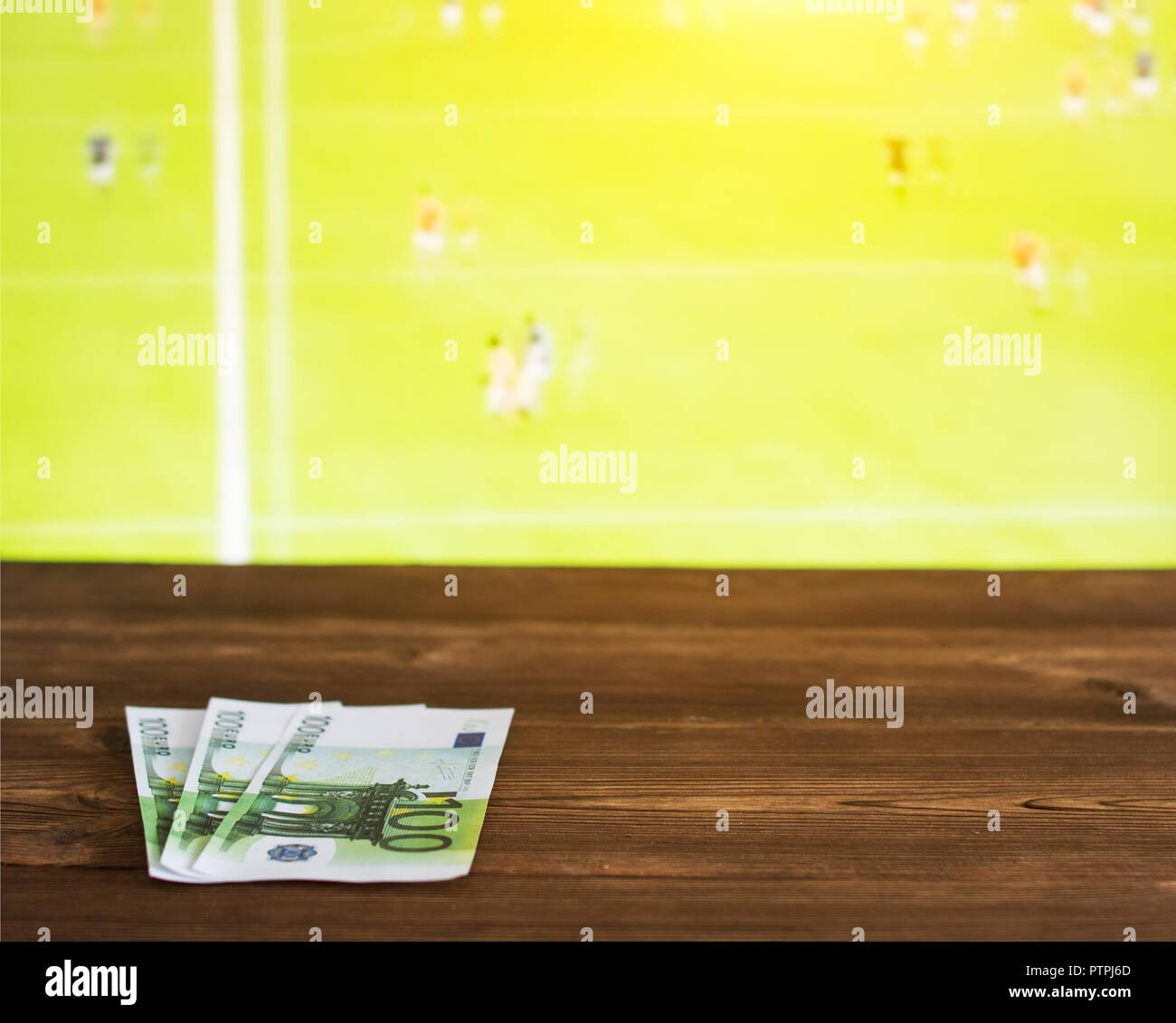 Euro money on the background of the TV on which show Gaelic football, sports betting, Gaelic Football Stock Photo