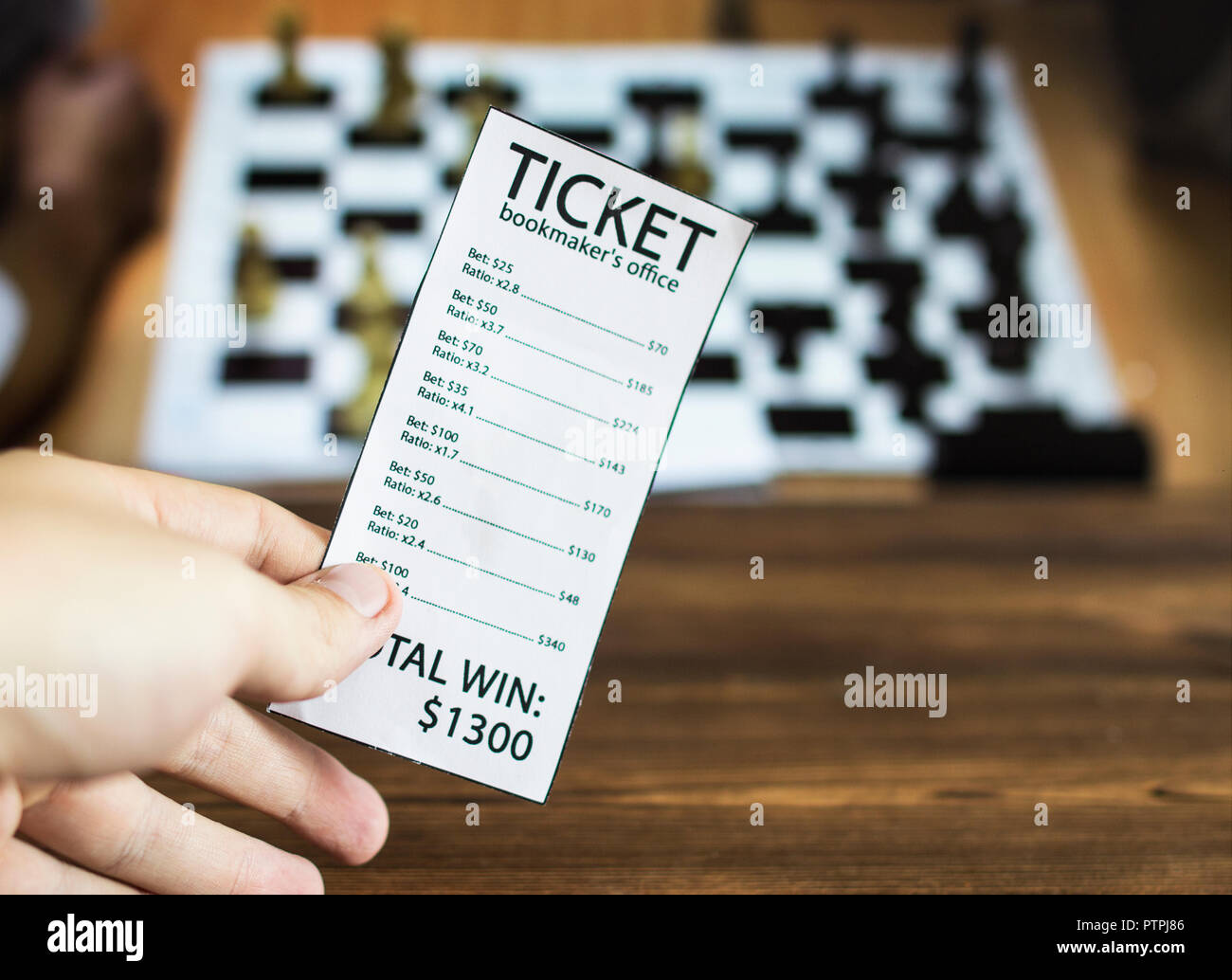Bookmaker ticket on the background of the TV on which the sport is shown playing chess, checkers, sports betting, chess, bookmaker Stock Photo