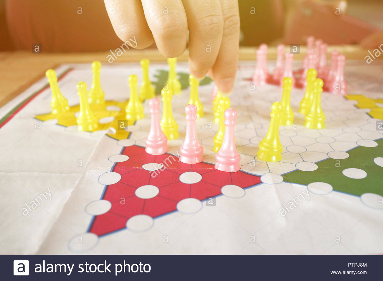 People playing chinese checkers. Stock Photo
