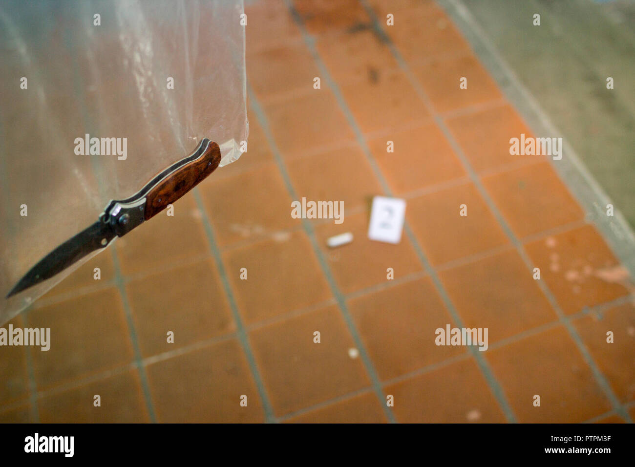 Stubby stub and folding knife in the forensic package, investigation, murder in the entrance - Stock Image