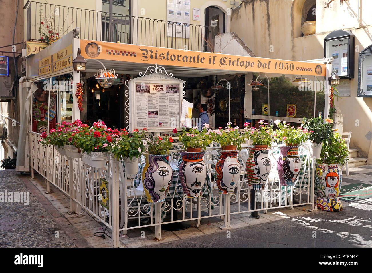 Idyllic restaurant at Corso Umberto I, main road of the old town of Taormina, Sicily, Italy Stock Photo