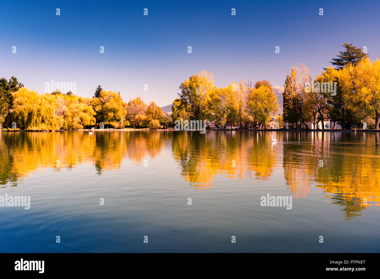 Autumn colors and reflection on the Puigcerda's pond water Stock Photo