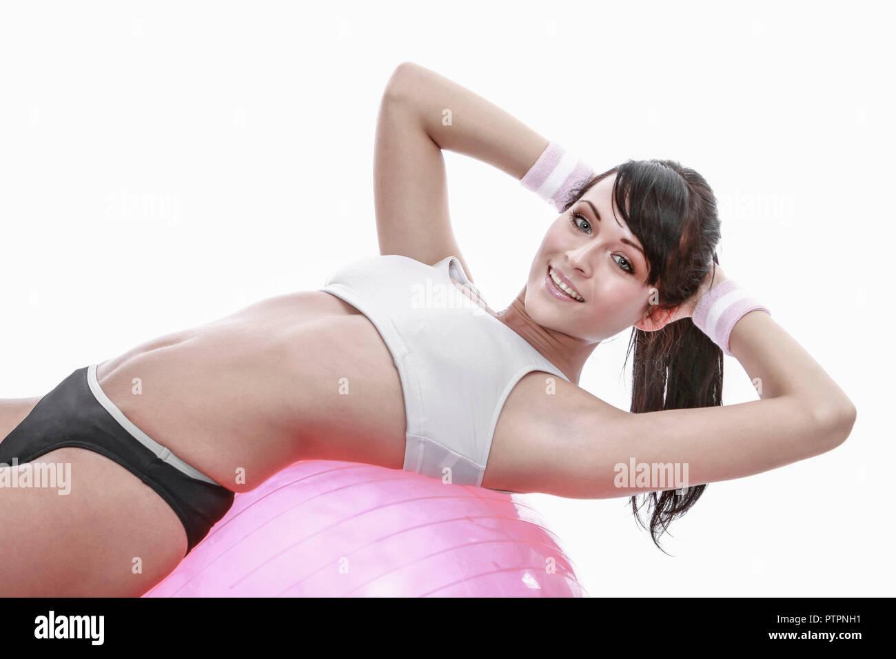 Aktiv, Ball, Bewegung, Fitness, Fitnessraum, Fitnessstudio, Gesundheit, Gymnastik, Innenaufnahme, Ruecken, Rueckengymnastik, Sport, Sportbekleidung, S - Stock Image