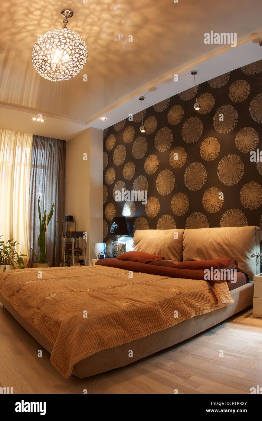 Interior of a modern bedroom in brown tones - Stock Image