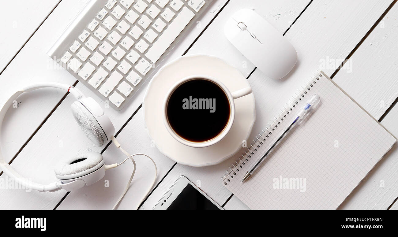 Devices and stationery near hot drink Stock Photo