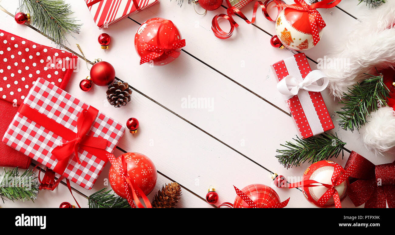 Border from Christmas presents and decorations - Stock Image