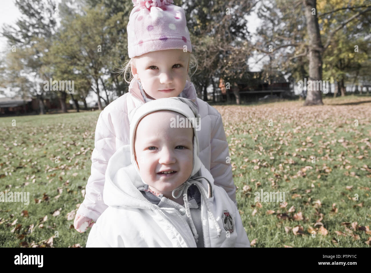 Little boy and girl on a meadow, portrait (Modellfreigabe) Stock Photo