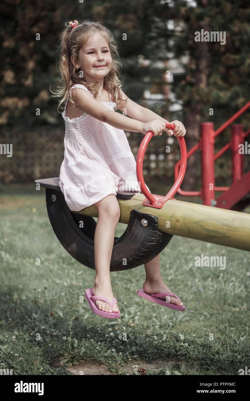 A little girl having fun on the swing (Modellfreigabe) Stock Photo