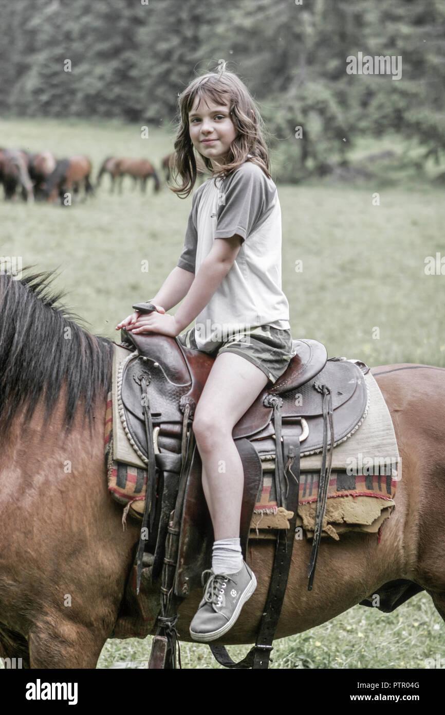 Girl riding a horse (Modellfreigabe) Stock Photo