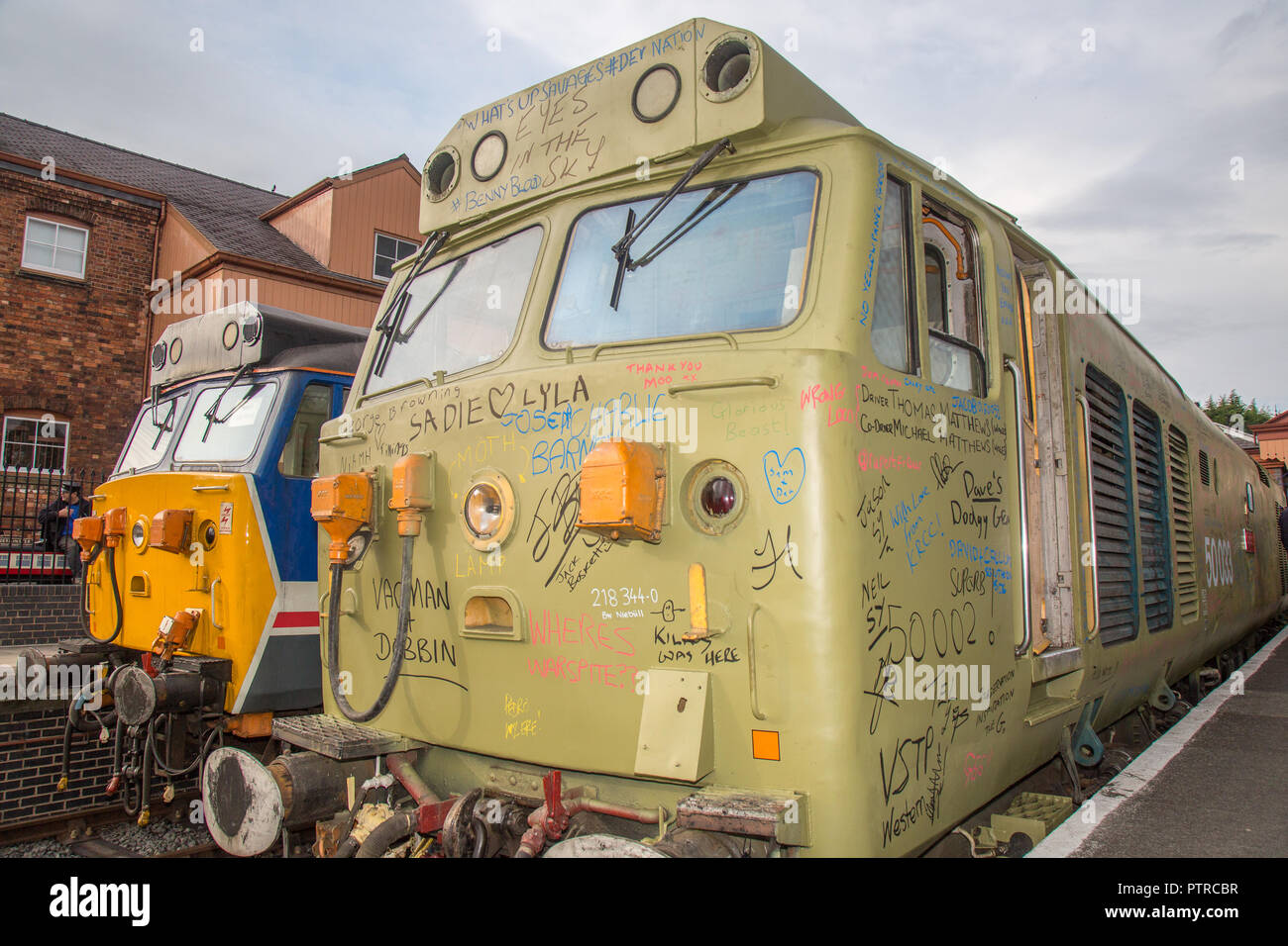 Diesel Class 50 Golden Jubilee celebrations at Severn Valley Railway. Enthusiasts graffiti messages on 50033 Glorious & donate towards her repainting. - Stock Image