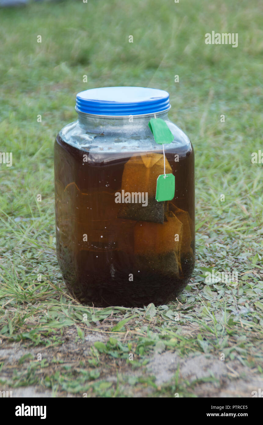 A jar of sunshine tea brews in the sun in a campground in Myrtle Beach ,South Carolina - Stock Image