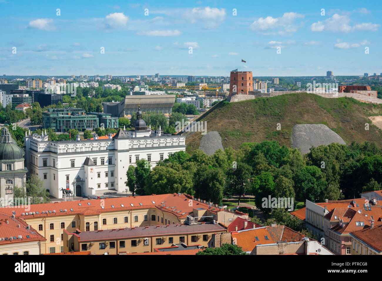 Vilnius Lithuania, aerial view across the roofs of Vilnius old town towards the Palace Of The Grand Dukes of Lithuania and Gediminas Hill. - Stock Image