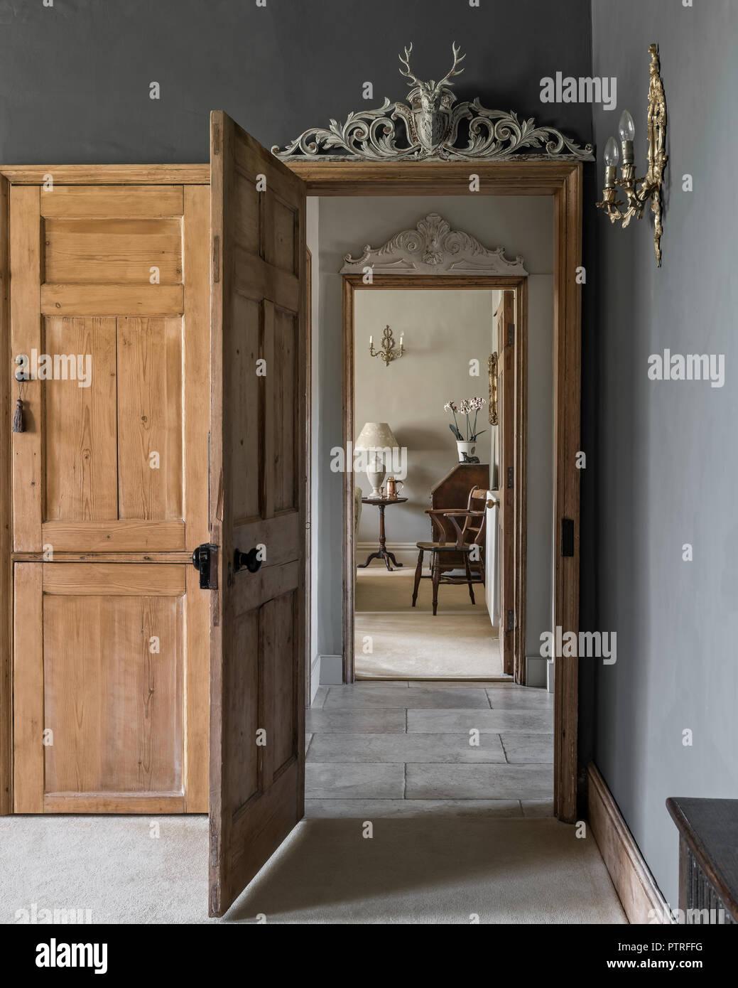 View through wooden doorway in restored Norfolk farmhouse - Stock Image