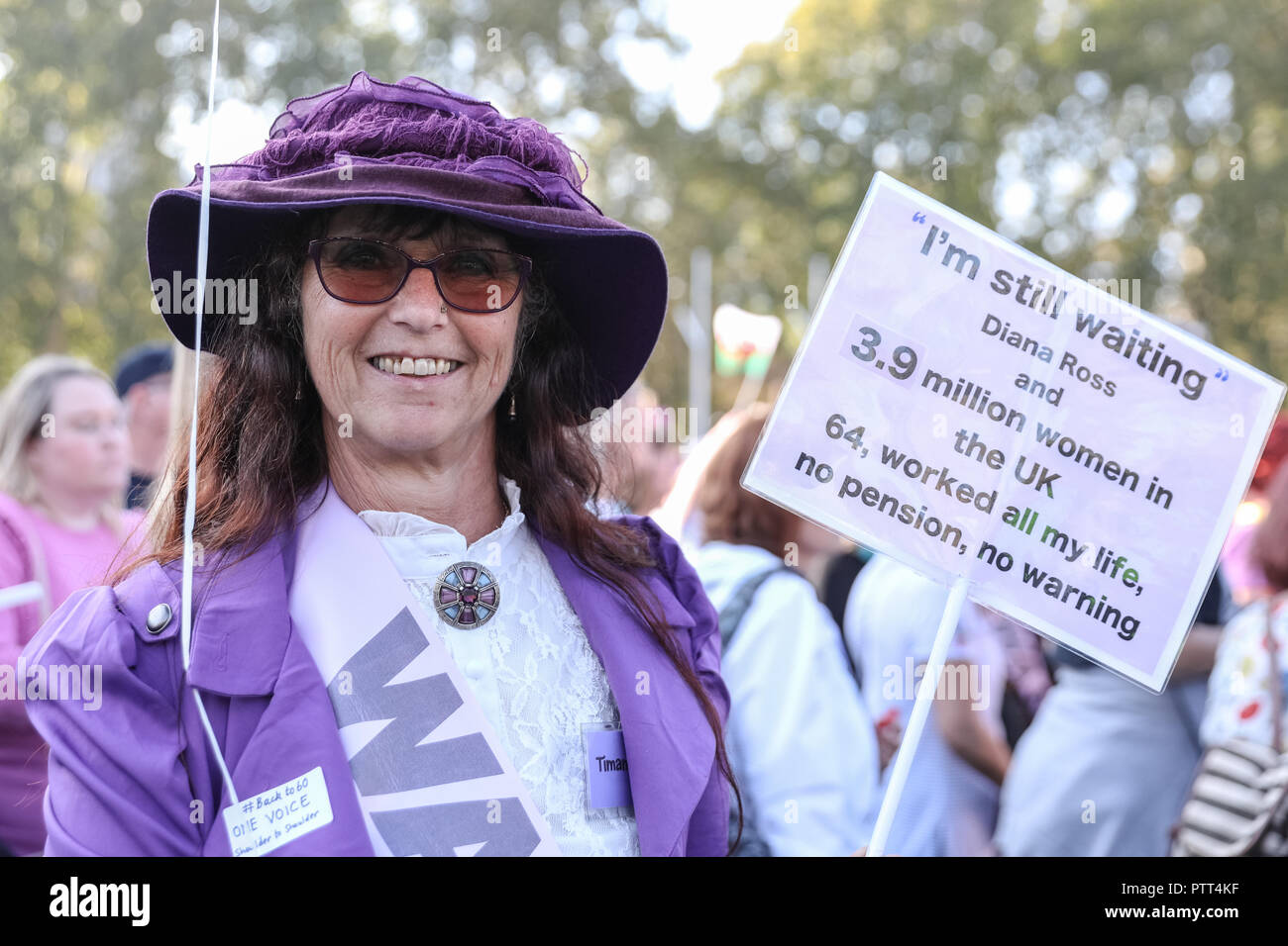 Westminster, London, 10th Oct 2018. A campaigner in suffragette costume shouts for pension equality. Women's pension groups, including the WASPI Campaign, have organised a march from Hyde Park to Parliament Square where several thousand women demonstrate for pension equality in British state pensions. Credit: Imageplotter News and Sports/Alamy Live News - Stock Image