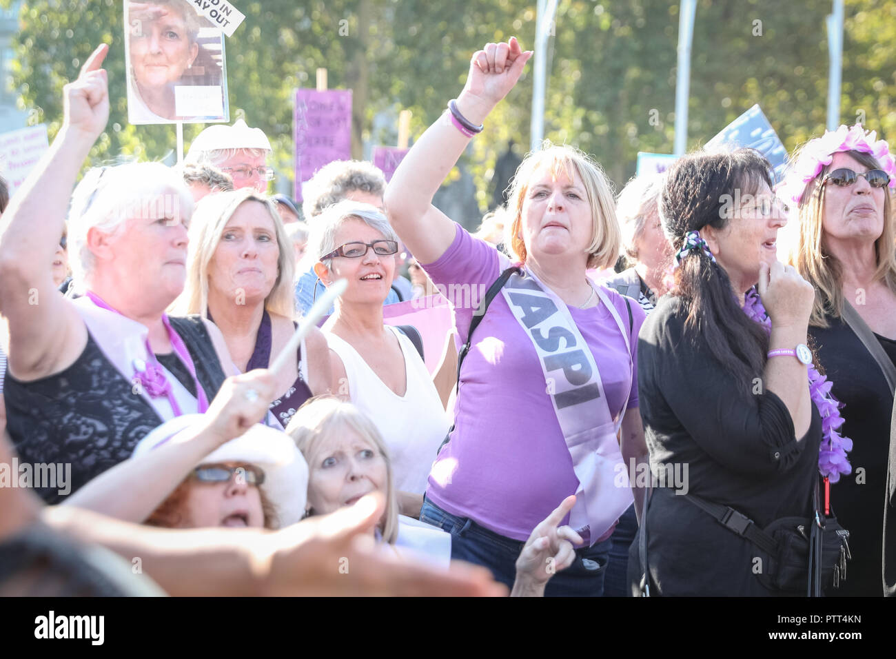Westminster, London, 10th Oct 2018. Campaigners shout for pension equality. Women's pension groups, including the WASPI Campaign, have organised a march from Hyde Park to Parliament Square where several thousand women demonstrate for pension equality in British state pensions. Credit: Imageplotter News and Sports/Alamy Live News - Stock Image