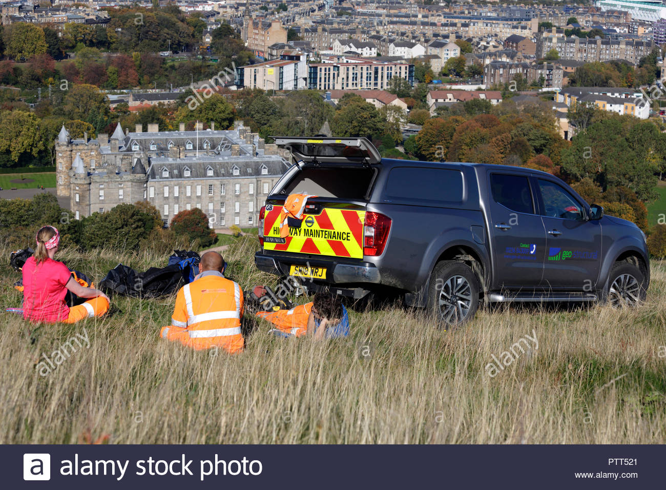 Edinburgh, United Kingdom. 10th October, 2018. Geo-Structural Geotechnical and Structural solutions car parked above Salisbury Crags on Arthurs seat on a clear sunny day. Palace of Holyrood House visible. Credit: Craig Brown/Alamy Live News. - Stock Image