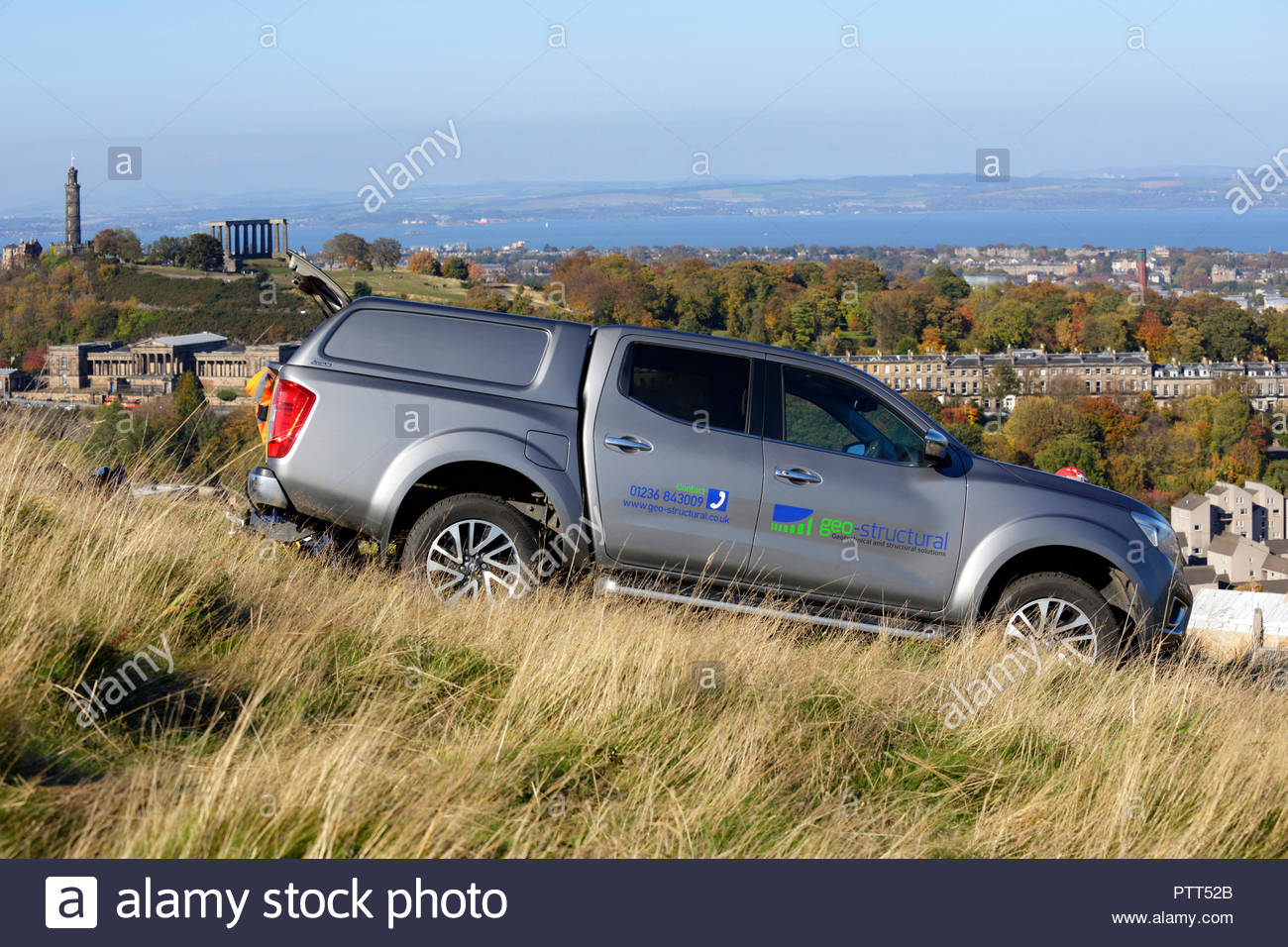 Edinburgh, United Kingdom. 10th October, 2018. Geo-Structural Geotechnical and Structural solutions car parked above Salisbury Crags on Arthurs seat on a clear sunny day. Calton Hill visible. Credit: Craig Brown/Alamy Live News. - Stock Image